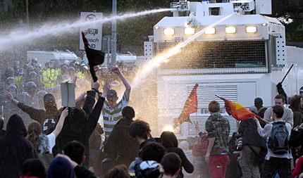 Police use water cannon on an unarmed public for the TV cameras in May 2004